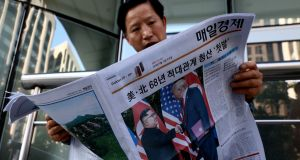A South Korean man reads a newspaper reporting the US president Donald Trump meeting with North Korean leader Kim Jong-un on Tuesday in Seoul, South Korea.  Photograph: Chung Sung-Jun/Getty Images