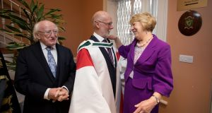 President Michael D. Higgins and his wife Sabina congratulate Pádraig Yeates after he was conferred a degree of Doctor of Literature by the National University of Ireland. Photograph: Tom Honan.
