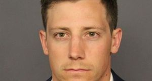FBI agent Chase Bishop appears in a booking photo released by the Denver District Attorney's Office.