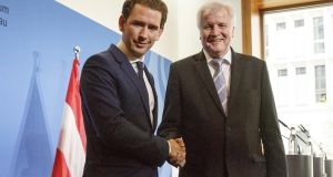 Austrian chancellor Sebastian Kurz (left) and German interior minister Horst Seehofer shake hands following a press conference  in Berlin on Wednesday. Phototgraph: Carsten Koall/Getty Images