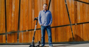Travis VanderZanden, the founder of Bird, with one of the startup's electric scooters in Santa Monica, California Photograph: The New York Times