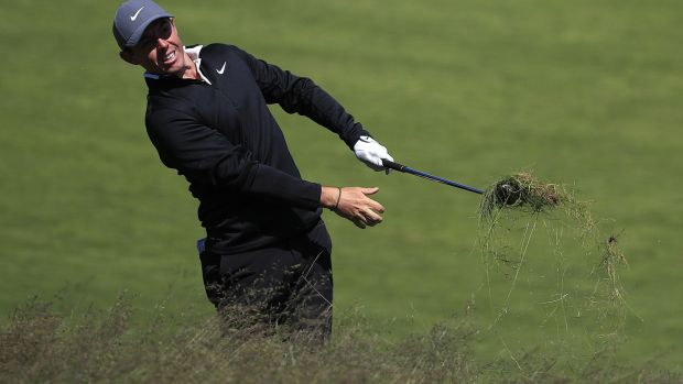 Rory McIlroy hits out of the rough during practice ahead of the US Open. Photograph: Tannen Maury/EPA