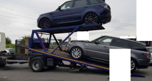 A redacted Garda photo of SUVs seized on Wednesday in west Dublin.  Photograph:   Garda Press Office