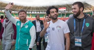 Chechen leader Ramzan Kadyrov (L) with Mohamed Salah during an Egypt training session. Photograph: Kazbek Vakhayev/EPA