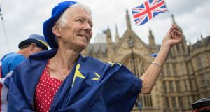 Helen Slater, from Bristol, joins anti-Brexit demonstrators as they wave European Union and Union flags outside the Houses of Parliament in London on Wednesday. Photograph: Rick Findler/PA Wire