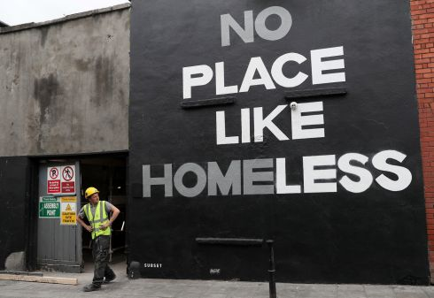 MAKING A STATEMENT: A man looks at a new mural in Dublin's city centre by art group Subset. According to the latest figures from the Department of Housing, there are almost 10,000 people homeless across Ireland, including 3,755 children. Photograph: Brian Lawless/PA Wire