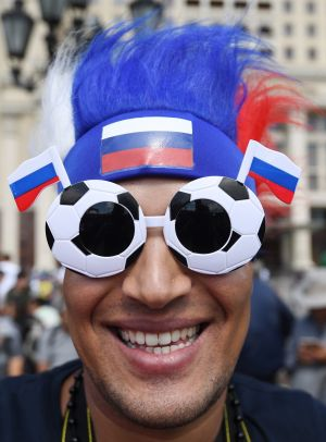 SHOW YOUR COLOURS: Fans gather near the Red Square in Moscow ahead of Russia's Fifa World Cup opener against Saudi Arabia tomorrow. Photograph: Facundo Arrizabalaga/EPA