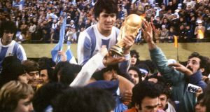 Argentina's national soccer team captain Daniel Passarella holds the World Cup trophy on June 25th, 1978, in Buenos Aires. Photograph: Staff/AFP/Getty Images