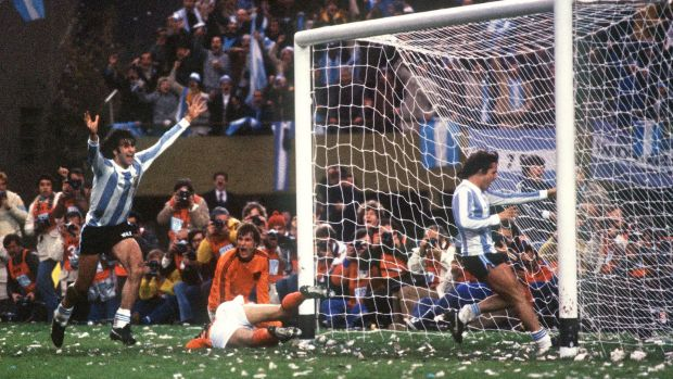 Argentinian midfielder Mario Kempes celebrates in front of forward Daniel Bertoni and Dutch defenders Wim Suurbier (on ground) and Ruud Krol on June 25th, 1978, in Buenos Aires. Photograph: Staff/ AFP/Getty Images