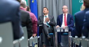 Taoiseach Leo Varadkar with Tánaiste Simon Coveney at the launch of Global Ireland Footprint to 2025  in Dublin on Monday. Photograph: Cyril Byrne