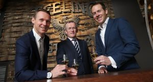 Teeling Whiskey founder and MD Jack Teeling, left, with Niall Gibbons, CEO Tourism Ireland, and Stephen Teeling, sales and marketing director at its distillery in the Liberties. Photograph: Robbie Reynolds
