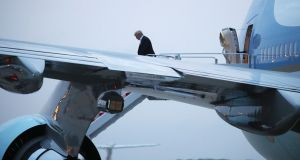 "US president Donald Trump steps off Air Force One on return from Singapore: ""Everybody can now feel much safer than the day I took office,"" he tweeted. Photograph: Mark Wilson/Getty"