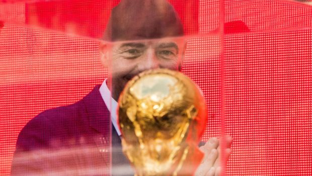 Fifa President Gianni Infantino looks at the World Cup trophy. Photograph: Mladen Antonov/AFP/Getty