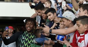 Nigeria Alex Iwobi poses with fans. Photograph: Pius Utomi Ekei/AFP/Getty