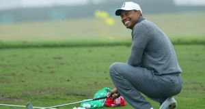 Tiger Woods of the United States smiles on the range prior to the 2018 US Open at Shinnecock Hills Golf Club in Southampton, New York. Photo: Warren Little/Getty Images