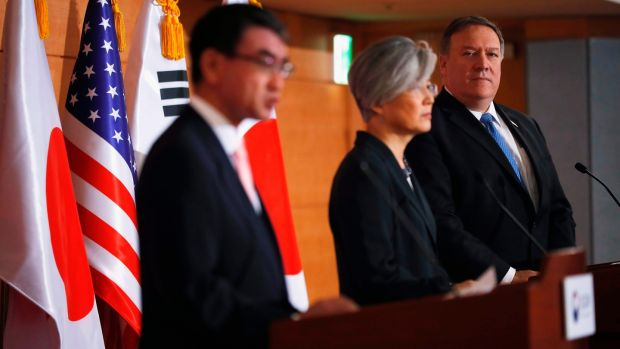 Mike Pompeo with South Korea's foreign minister Kang Kyung-wha (centre) and Japan's foreign minister Taro Kono at a joint news conference in Seoul. Photograph: Kim Hong-Ji/AFP/Getty Images