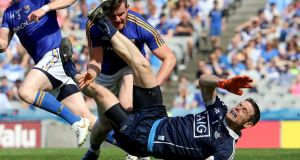 Dublin's Stephen Cluxton is fouled by James McGivney of Longford during the Leinster semi-final. Photo: Bryan Keane/Inpho