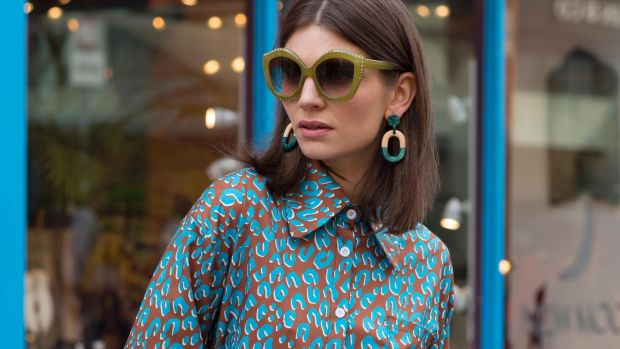 Abstract print shirt, €58, vintage golf trousers, €45, sunglasses, €28, teal earrings, €28, at Om Diva