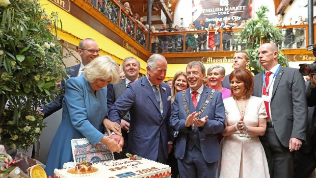 Prince Charles, Prince of Wales and Camilla, Duchess of Cornwall meet fishmonger Pat O'Connell as they visit the English Market.