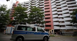 A police car stands in front of an apartment building in Cologne,  Germany, where a man suspected of trying to build a biological weapon was arrested.  Photograph: dpa/Oliver Berg/Germany/AFP/Getty Images