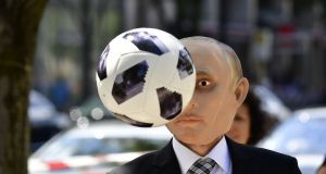 An activist of Reporters without Borders wears a mask depicting Russian President Vladimir Putin during a protest in front of the Russian embassy to Germany in Berlin, ahead of the start of the 2018 Football World Cup. Photograph: Tobias Schwarz/AFP/Getty