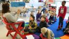 Erin Vogel reads aloud to her second-grade class at Crestwood Elementary School. Photograph:  Jessica Mendoza/The Christian Science Monitor