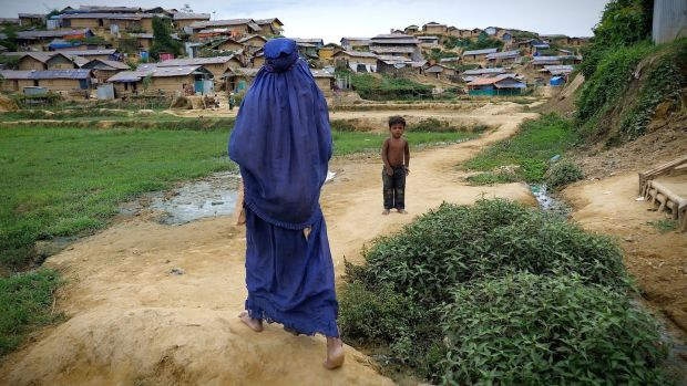 Birth attendant Noor Jahan (60) walking through Jamtoli camp, one of 20 Rohingya refugee camps in the Cox's Bazar district of southern Bangladesh. Photograph: Kathleen Harris