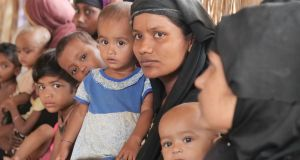Mothers and babies wait at a Concern Worldwide outpatient centre for malnutrition screening. Photograph: Kathleen Harris