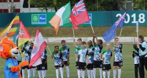 Daniel McCabe (12), from Dundalk, Co Louth, carrying the Irish flag at a football event in Russia ahead of taking part in the opening ceremony of the World Cup.