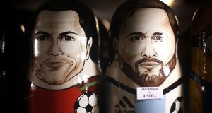 Russian dolls of Cristiano Ronaldo of Portugal and Lionel Messi of Argentina in a souvenir shop in Moscow. Photograph: Ryan Pierse/Getty Images