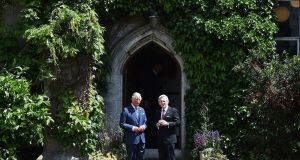 Prince Charles speaks to  UCC president Prof Patick O'Shea during a visit to the university on Thursday. Photograph:  Charles McQuillan/Getty Images.