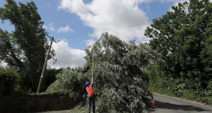 An ESB crew works to restore power to homes near Naas in Co Kildare after Storm Hector. Photograph: Niall Carson/PA Wire