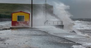 Waves crash over the lifeguard hut at Silver Strand in Galway during Storm Hector. Photograph: Joe O'Shaughnessy