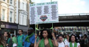 The silent procession marking the   one-year anniversary of the Grenfell Tower fire  in London in which 72 people lost their lives. Photograph: Dan Kitwood/Getty