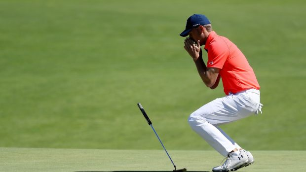 Jordan Spieth reacts after missing a putt during the opening round of the US Open. Photograph: Rob Carr/Getty
