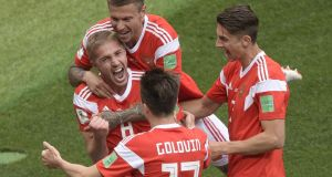 Yuri Gazinskiy  celebrates scoring Russia's opening goal with team-mates in the World Cup opener against Saudi Arabia at the Luzhniki Stadium in Moscow. Photograph: Juan Mabromata/AFP/Getty Images