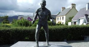 Steve 'Crusher' Casey is memorialised by a bronze statue in his hometown of Sneem. Photograph: Peter Dorgan/Wikimedia Commons