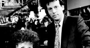 Leslie Grantham in character as Dennis Watts with his on-screen wife Anita Dobson who played Angie.  Press Association