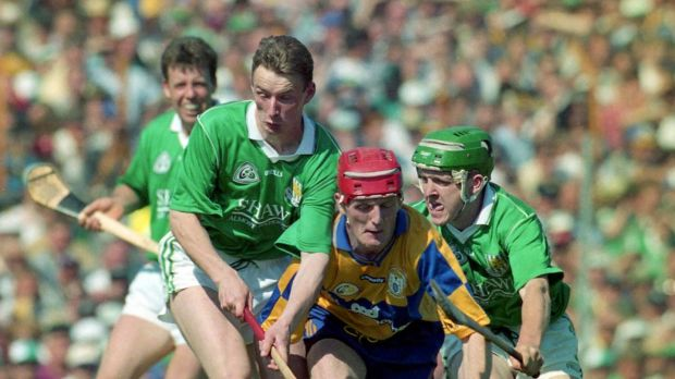 Clare's Brian Lohan is challenged by Limerick's Pádraig Tobin during the Munster semi-final in 1996. Photograph: Lorraine O'Sullivan/Inpho