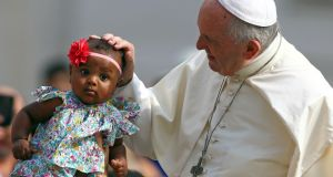 Pope Francis blesses a child in Saint Peter's Square: Irish Catholics  have to deal with  a kind of casual sectarianism that the cultural elite would find unthinkable in relation to Muslims. Photograph: Tony Gentile