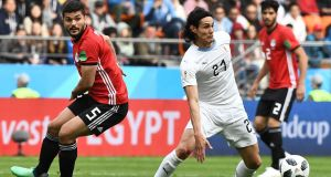 Uruguay's forward Edinson Cavani (R) vies with Egypt's midfielder Sam Morsy (L) during the Group A football match between Egypt and Uruguay. Photograph: Christine Poujoulat/AFP/Getty Images