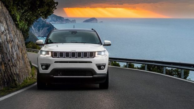 The brand's signature seven-slot grille runs the width of the front of the Jeep Compass