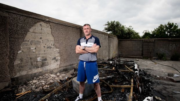 William McDonagh at his burnt-out caravan on St Mary's Halting Site, Cappagh Road, Finglas, Dublin. Photograph: Tom Honan
