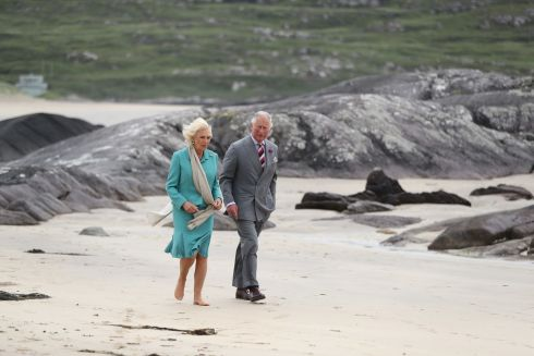 The Prince of Wales and Duchess of Cornwall walk on Derrynane beach in Co Kerry during the royal tour of the Republic of Ireland. Photo : Niall Carson/PA Wire