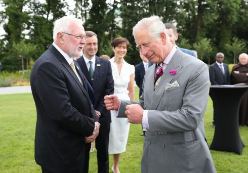 The Prince of Wales meeting Sinn Fein's Martin Ferris at a Garden Party at Killarney House as part of their tour of the Republic of Ireland. Photo: Niall Carson/PA Wire