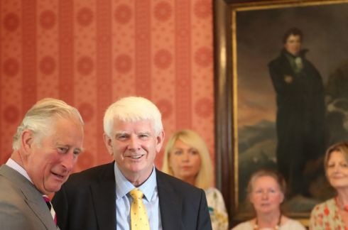 The Prince of Wales (left) meets John O'Connell during a visit to Derrynane House in Co Kerry as part of his tour of the Republic of  Ireland. The house was the ancestral home of Daniel O'Connell (seen in the painting in the background), John's great great grandfather. Photo : Niall Carson/PA Wire