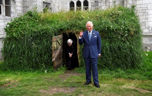 Prince Charles is shown a Famine-era mud hut at University College Cork. Photograph: Clodagh Kilcoyne/Reuters