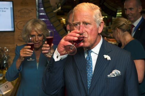 Prince Charles and his wife Camilla, the Duchess of Cornwall, raise a glass of during their visit to the English Market in Cork. Photograph: Clodagh Kilcoyne/Reuters
