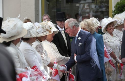 The royals meet people dressed in period costume during a visit to the English Market in Cork. Photograph: Steve Parsons/PA