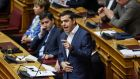Alexis Tsipras during a parliamentary session in Athens on Thursday. The Greek prime minister blinked first after he brought his country to the brink of crashing out of the euro in 2015.  Photograph: Angelos Tzortzinis/AFP/Getty Images